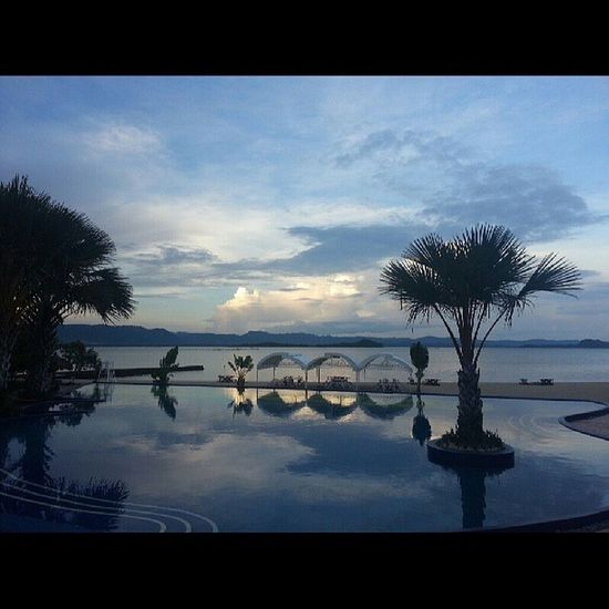Too bad this place is an exclusive resort. I would like to see this view again. Sunset Beach Sea Kiddiepool trees silhouette nofilter chill work travel quezonprovince