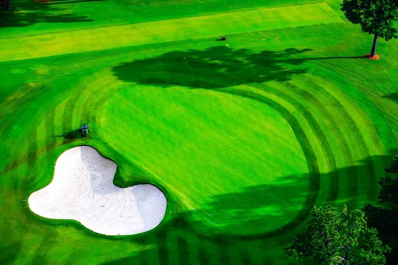 A beautiful day on the course! Golfing Golf Golf Course Water No People Plant Beauty In Nature Outdoors High Angle View Tranquility Landscape Activity Environment Sport