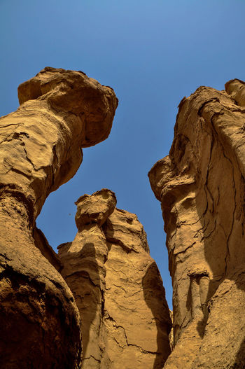 Qarah Caves - Al hasa, Saudia Arabia Desert Saudi Arabia Al Hasa Arid Climate Beauty In Nature Clear Sky Day Geology Low Angle View Natural Arch Nature No People Osaisen Outdoors Physical Geography Rock - Object Rock Formation Scenics Sky Tranquil Scene Tranquility Travel Destinations