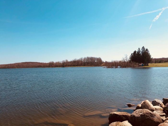 Hints of the red Sky Water Tranquility Beauty In Nature Tranquil Scene Scenics - Nature Tree Plant Lake Nature Blue Day Non-urban Scene Clear Sky Copy Space Idyllic No People Outdoors Rock