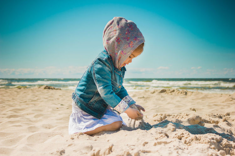 Beach Sea Sand Summer Kid Childhood Girl Land Child Water Real People Leisure Activity One Person Nature Sky Full Length Lifestyles Casual Clothing Trip Holiday Day Horizon Over Water Innocence Outdoors