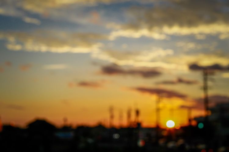 Sunset No People Sky Silhouette Focus On Foreground Outdoors Nature City Built Structure Building Exterior Illuminated Beauty In Nature Architecture Close-up Day