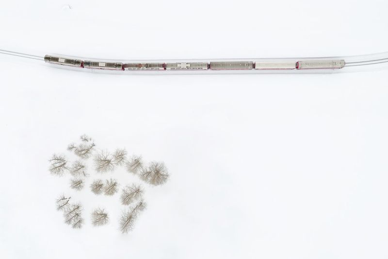 Directly Above Shot Of Train Moving On Snowy Field