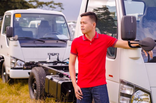 Red Casual Clothing! Transportation Mode Of Transport Car Land Vehicle Casual Clothing Standing One Person Mechanic Men Day Outdoors Working Real People Young Adult One Man Only Adult