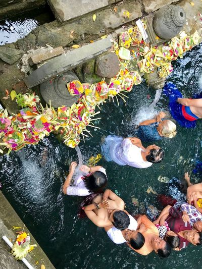 High angle view of people swimming in pond