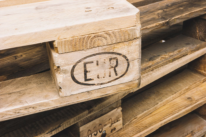 stacked Euro pallets in a store Advertising Business Industry Sale Stapel Traffic Transportation Weathered Wood Aged Business Finance And Industry Euro Europallet Europe Heap Load Packing Palette Shipping  Stacked Store Wood - Material