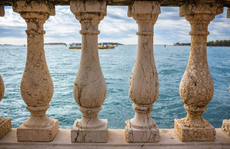 Scenic view of sea against sky seen through balustrades