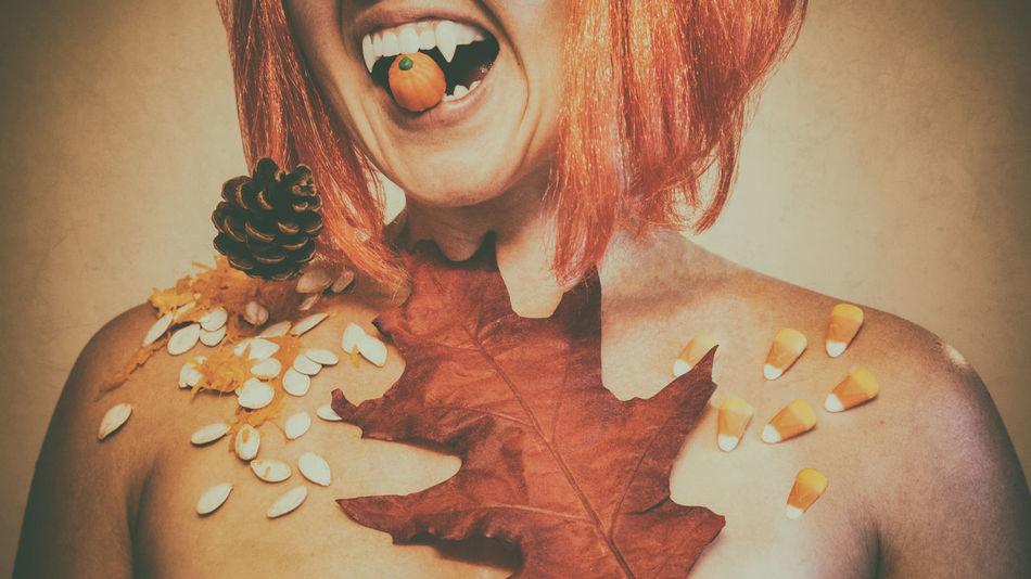 Autumn Autumn Leaf Orange Vampire Teeth  Woman Brown Candy Corn Close-up Cropped Fall Leaf One Person Orange Color Pine Cone Pumpkin Seeds Season  Seasonal Symbolism Whimsical