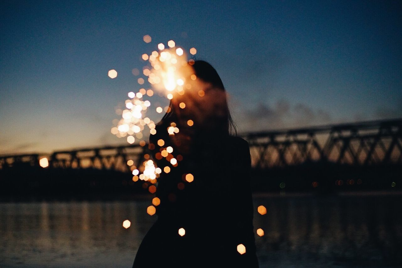 river, water, illuminated, bridge - man made structure, night, real people, one person, outdoors, sky, women, close-up, defocused, people