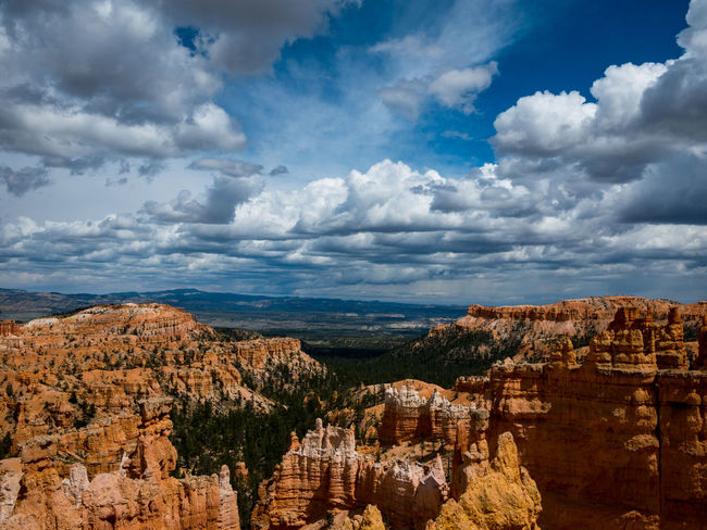 """""""The moments of happiness we enjoy take us by surprise. It is not that we seize them, but that they seize us."""" —Ashley Montag 🍀 Beauty In Nature Bryce Canyon Canyon Cloud - Sky Clouds And Sky Day EyeEm Gallery First Eyeem Photo Forest Geology Landscape Mountains Nature Nature No People Outdoors Rock Hoodoo Scenery Scenics Sky Stone Material The Great Outdoors - 2017 EyeEm Awards The Week On Eyem ColeurLandscape Live For The Story Place Of Heart Perspectives On Nature"""