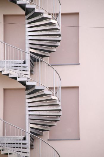 Low angle view of spiral staircase against building