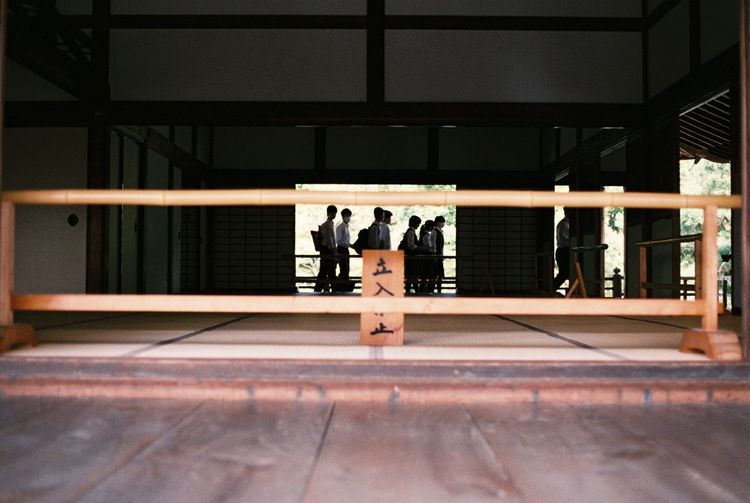 Analogue Photography Blurred Motion Contemporary Depth Of Field Film Film Photography Filmphoto Front View Fuji Superia X-Tra 400 Full Length Glass Glass - Material Indoors  Journey Kyoto Pattern Railing Real People Selective Focus Side View Sitting Standing Student Tenryuu-ji Temple Wall