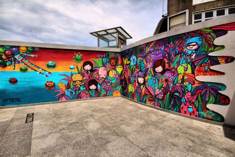 Welcom in Brasil Brasil Graffiti Multi Colored Art And Craft Street Art Creativity Architecture Artist Day Built Structure Modern Building Exterior Painted Image Outdoors Sky People