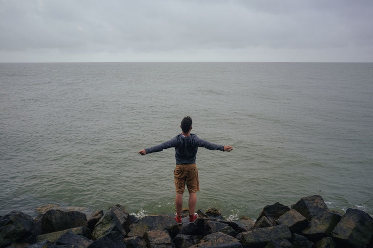 man screaming at the sea Alone Cloudy Empty Full Length Grey Landscape Male Man Ocean One Person Outdoors Overcast People Person Screaming Sea Tranquil Scene Tranquility Vast