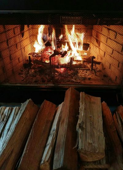 Fire in the fireplace! 🔥 Cold Night, Hot Fire Ambience Indoors  Logs Winter Night Winter Night Mood Image EyeEm Gallery Cell Phone Photography