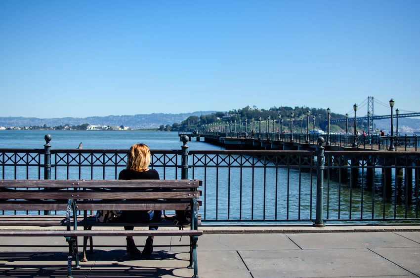 Lady on the bench Bench Blue Casual Clothing City City Life Clear Sky Day Embarcadero Leisure Activity Lifestyles Nature Observation Point Outdoors Pier Rearview Relaxation Sanfrancisco SF Sitting Sky Street Sunlight Sunny Vacations Water Market Reviewers' Top Picks
