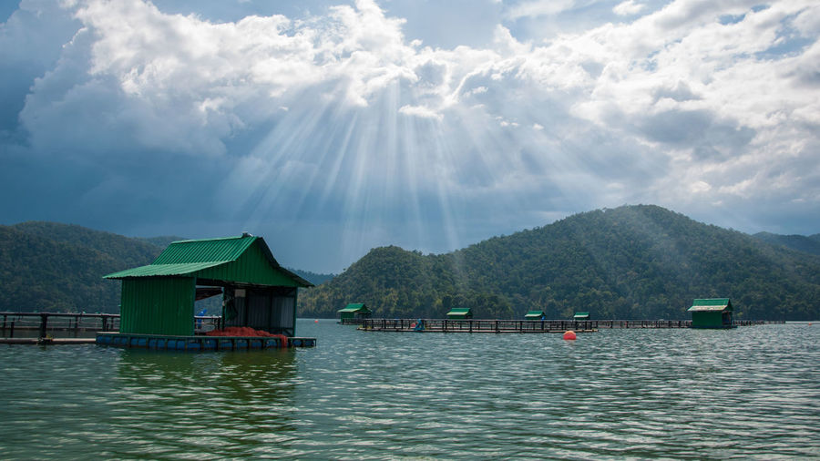 Floating Houses On Scenic Mountain Lake