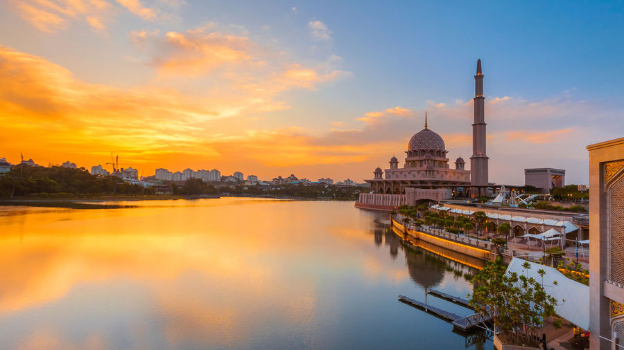 A Golden beautiful sunset by the Putrajaya lake Architecture Built Structure Capital Cities  City City Life Cityscape Cloud Cloud - Sky Golden Malaysia Mosque Mosques Nature No People Orange Color Outdoors Putrajaya Reflection River Scenics Sky Sunset Tourism Travel Destinations Water