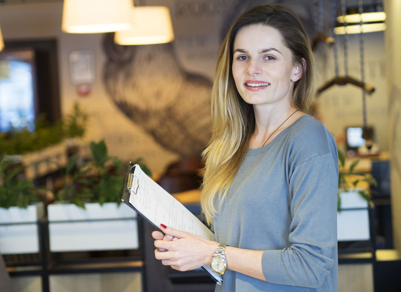 Shot of a young woman working in a restaurant Real Small Business Working Beauty In Nature Caucasian Food Industry Restaurant Smille Smilling Young Adult