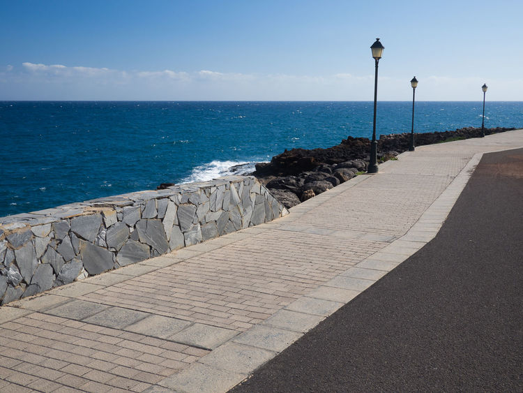 Promenade at the sea Beach Beauty In Nature Blue Blue Sea Cliff Day Foothpath Horizon Over Water Lamps Landscape_photography Laterna Nature No People Ocean Ocean View Outdoors Promenade Scenics Sea Seascape Sky Travel Destinations Vacations Water Way