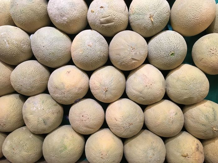 Full Frame Shot Of Honeydew Melons At Market For Sale