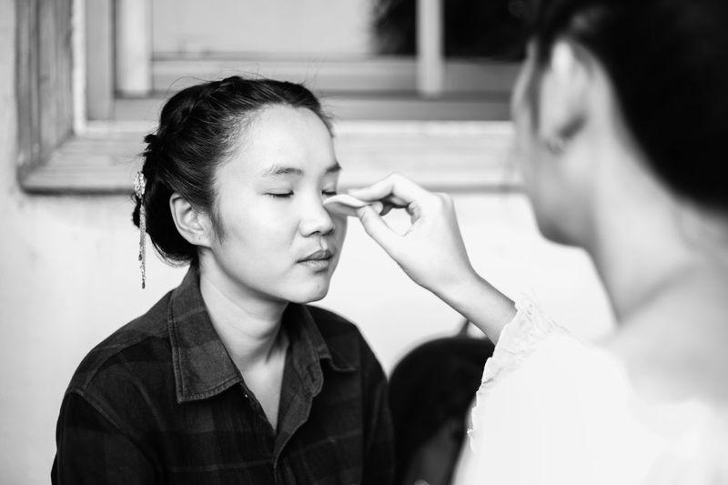 Artist Applying Make-Up To Woman