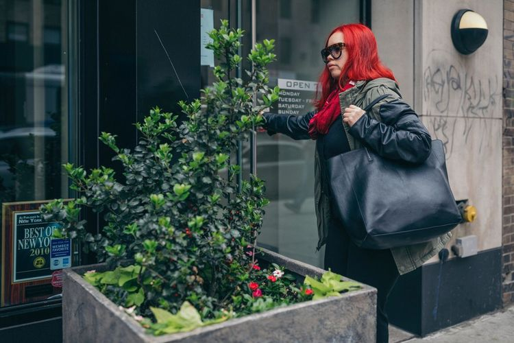 The Street Photographer - 2017 EyeEm Awards One Person Real People Outdoors Lifestyles Building Exterior Standing Jacket Day Leisure Activity Women Young Adult Red Young Women Warm Clothing Architecture Full Length People