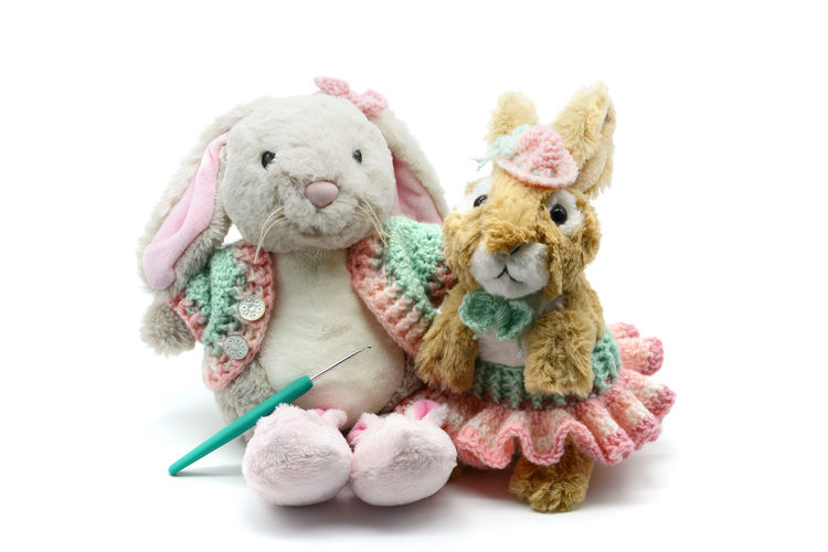 two Easter rabbits with crochet clothes on white isolated background. Bunny 🐰 Crocheting Easter Easter Bunny Easter Buns Bunny  Childhood Close-up Crochet Crochet Hook Crocheted Crocheting Is My Hobby Crochetlove Doll Easter Bunnies  No People Studio Shot Stuffed Toy Toy White Background Wool