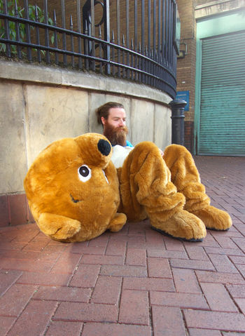 Man in teddy bear suit, sitting on London street Actor Animal Themes Bizarre Citylife Contemplation Day Dreams Fun Humour London Morning Problems Roleplay Sadness Summer Sun ☀ Young Adult