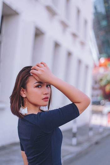 Portrait of a beautiful young woman in city