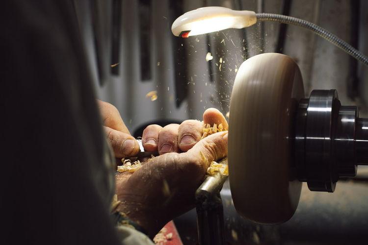 Close-up of man working in machine