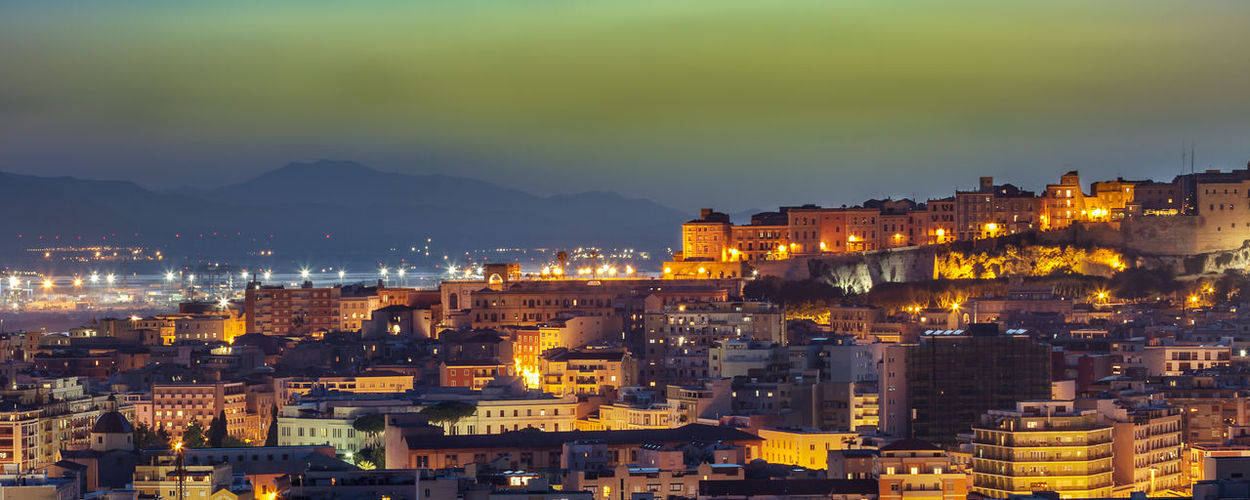 Cagliari by Night - Panoramic View Cagliari Sardinia Italy Panorama Panoramic Sunset Dusk Twilight Urban Skyline Architecture Building Exterior City Built Structure Cityscape Sky Building Illuminated Residential District Mountain Outdoors High Angle View Travel Destinations Night Mountain Range Evening