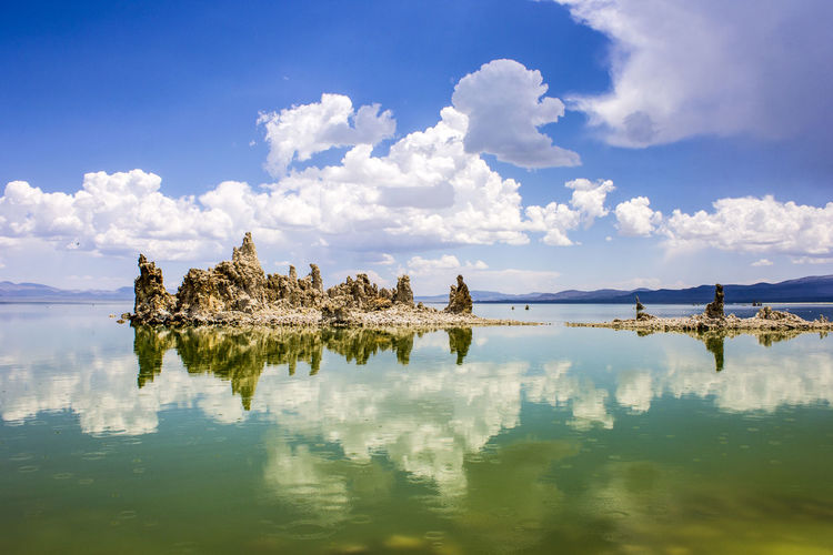 Mono Lake, a large, shallow saline soda lake in Mono County, California, with tufa rock formations Architecture Beauty In Nature Built Structure Cloud - Sky Day Lake Mono Lake Mono Lake California Nature No People Outdoors Reflection Scenics Sky Tranquil Scene Tranquility Travel Destinations Tufa Water Waterfront