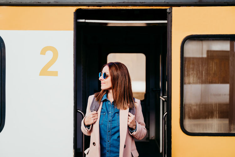 Full length of woman standing at train