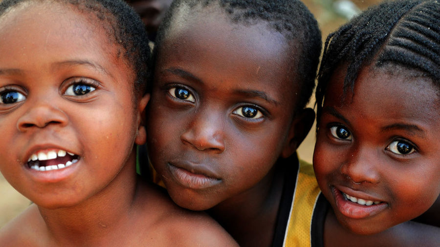Nigeria Africa Boys Childhood Close-up Elementary Age Friendship Girls Group Of People Happiness Human Face Looking At Camera Portrait Real People Smiling Village Life
