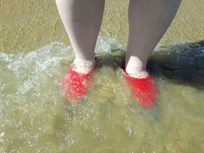 Red shoes in water with bear legs. Bare Legs Barefoot Casual Clothing Day Feet Fetish Human Foot Leisure Activity Lifestyles Low Section Outdoors Part Of Person Red Red Shoes Red Shoes A Smoke And A Curry Red Shoes And Bear Legs Seascape Standing Vacations Water