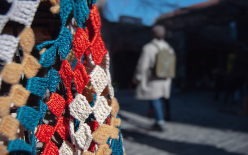 Close-up of multi colored decorations hanging on street