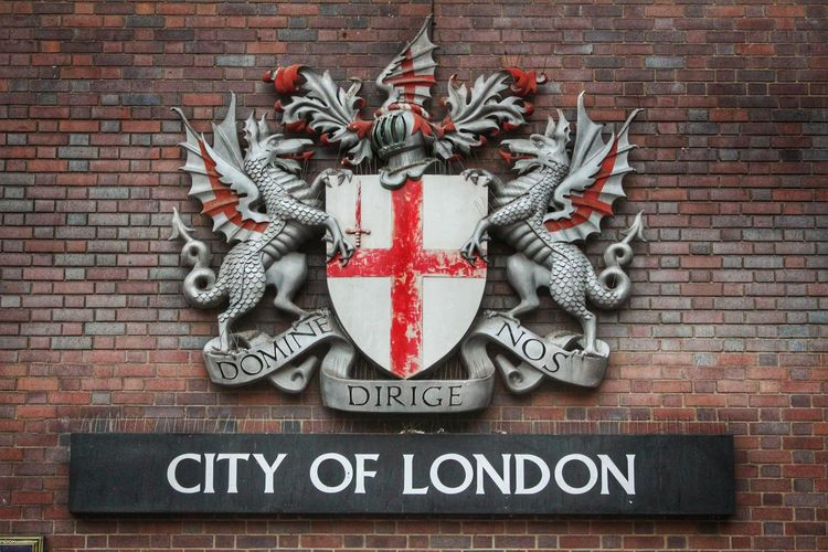 Barbican Centre City Of London Dragon England, UK Latin London Red Banner Barbican Brexit Brick Wall Capital City City Of London Tourism Close-up Coat Of Arms Crest Knight  Medieval Motto No People Red Silver  Text Tourist Destination Western Script