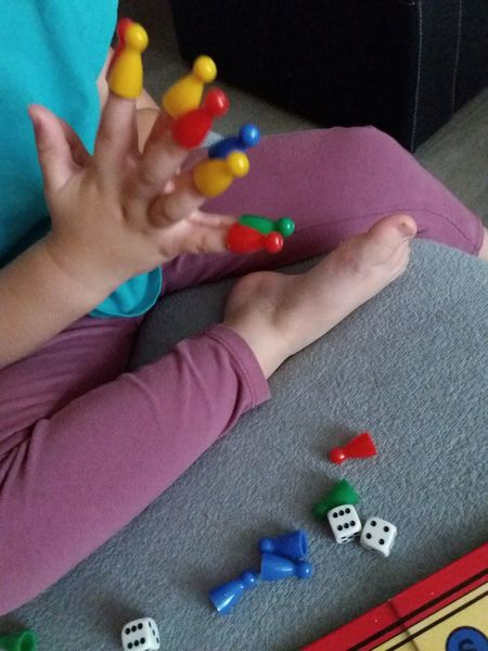 Human Body Part Multi Colored Human Hand Nail Polish Manicure Indoors  One Person Little Girl Colors Table Game Play Game Spiel Little Fingers Little Hands Fingers Hands Tiny Fingers Colorful Nails Long Fingers Long Nails Child Childhood Childsplay Children Playing