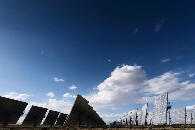 solar panels Sky Built Structure Architecture Building Exterior Low Angle View Cloud - Sky Nature City Building Day No People Blue Outdoors Office Building Exterior Sunlight High Section Copy Space Modern Office Solar Panels