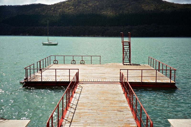 View Of Stairs In Calm Water