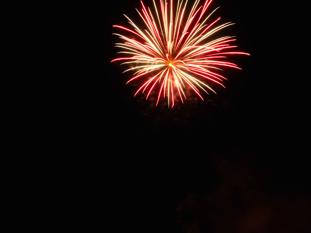 firework, arts culture and entertainment, celebration, event, night, firework display, exploding, motion, illuminated, low angle view, long exposure, no people, blurred motion, firework - man made object, glowing, sky, copy space, light, nature, dark, outdoors, sparks, black background