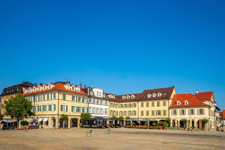 Buildings in town against blue sky