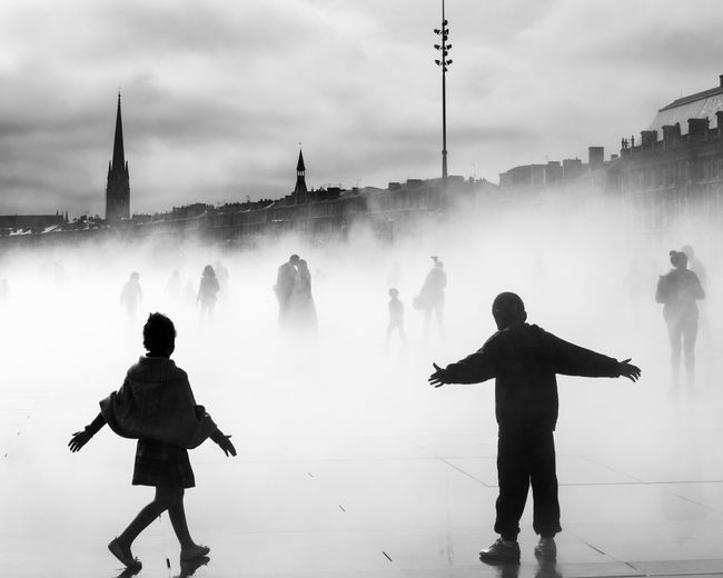 Kids Kids Being Kids Wedding Adventures In The City Building Exterior Built Structure City Day Fog Kidsphotography Lifestyles Men Motion Nature Outdoors People Playing Real People Sky Tourism Travel Travel Destinations Water Watermirror Women #FREIHEITBERLIN
