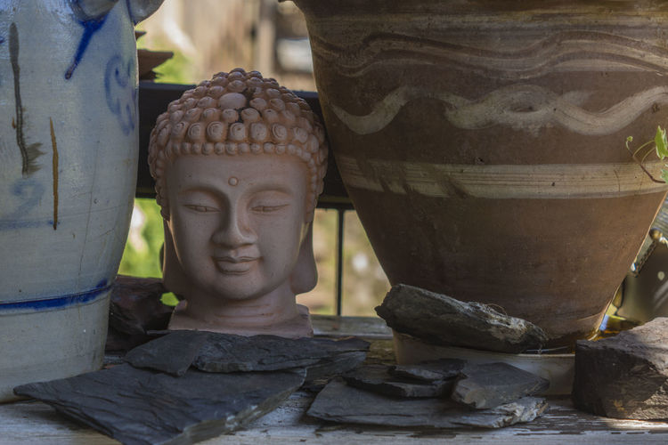 Statue Sculpture Human Representation Religion Spirituality Arts Culture And Entertainment No People Day Outdoors Garden Buddha Buddha Head EyeEmNewHere Buddhism Flowerpots