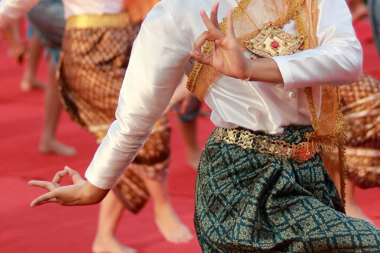 Midsection Of Woman Dancing During Celebration