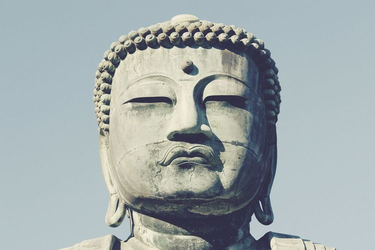 Low angle view of great buddha against sky