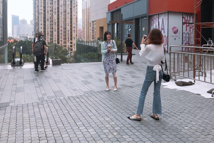 People walking on footpath in city