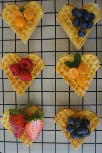 waffle hearts with fresh berries Waffle Heart Heart Shape Dessert Desserts On The Table Sweet Food Food Food And Drink Berry Fruit Berry Strawberry Blueberry Physalis Raspberry Directly Above Gelatin Dessert Dessert Directly Above Variation Sweet Food Close-up Food And Drink Tart - Dessert Cooling Rack Baked