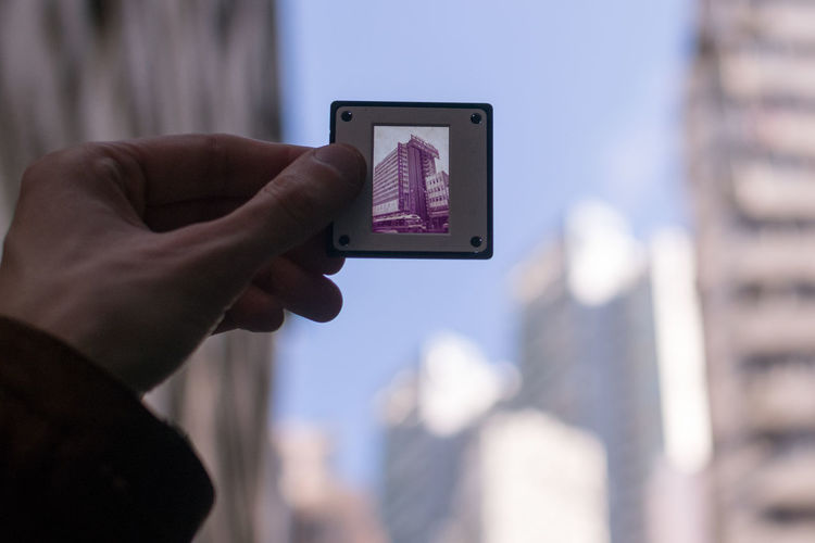 Human Hand Human Body Part Holding One Person Connection Photography Themes Focus On Foreground Photographing Selective Focus Architecture Slide Photo Film Analogue Photography Retro Analogue Sound